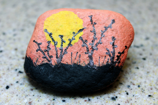 Sunset painted rock